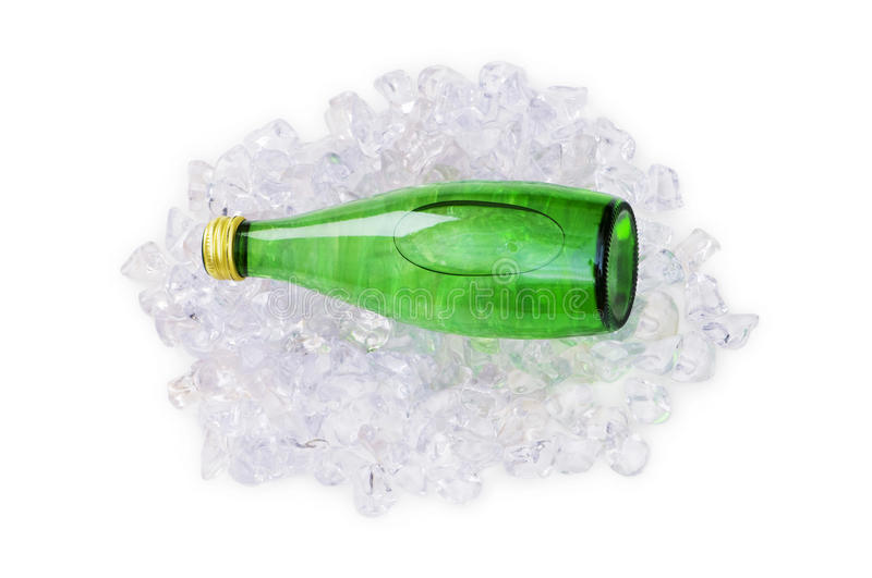 Green Bottle Of Water On Ice Royalty Free Stock Photo