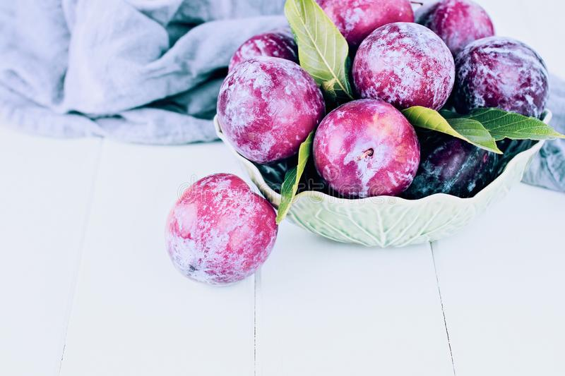 Green Bowl of Fresh Pickked Organic Plums stock image