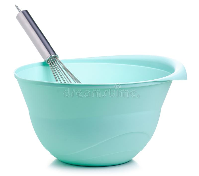 Green bowl and kitchen whisk corolla. On white backgrund isolation royalty free stock image
