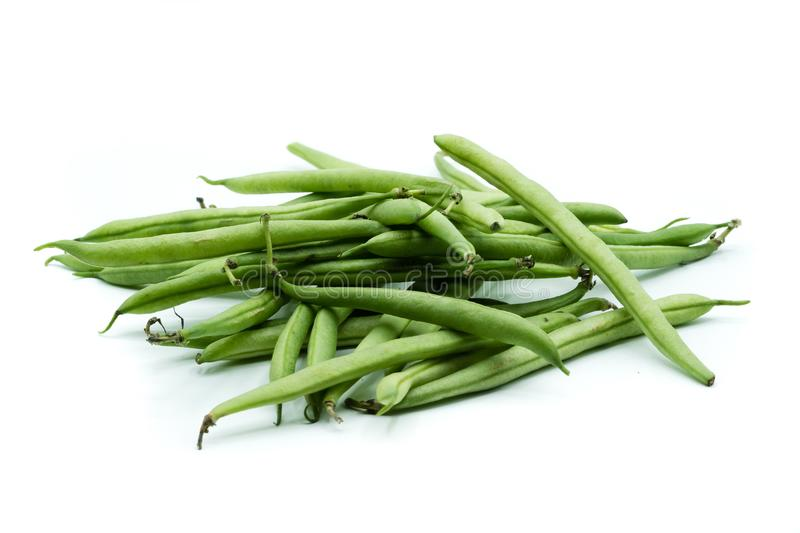 Green breaking beans heap isolated on white background. Green breaking beans heap isolated white background royalty free stock image