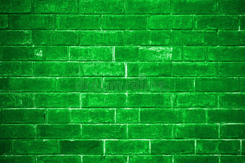 Green brick wall getting older from the bottom stock images