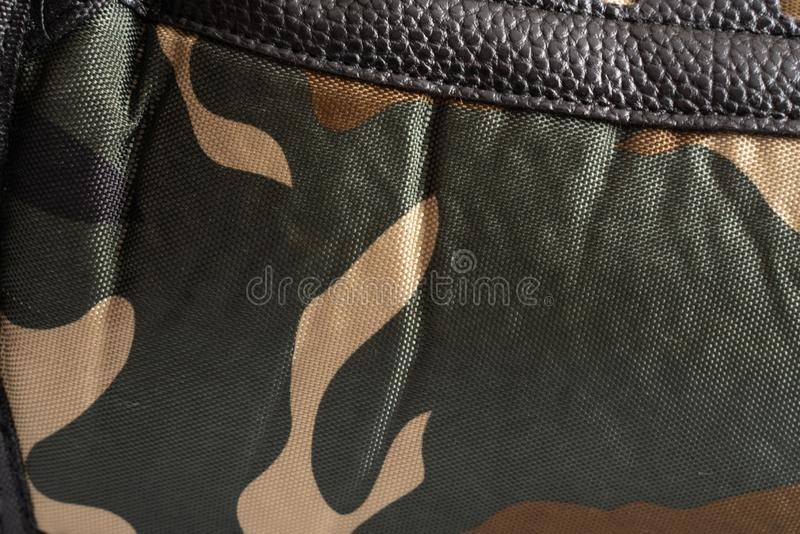 Green-brown Camouflage texture fabric close-up abstraction background stock photography