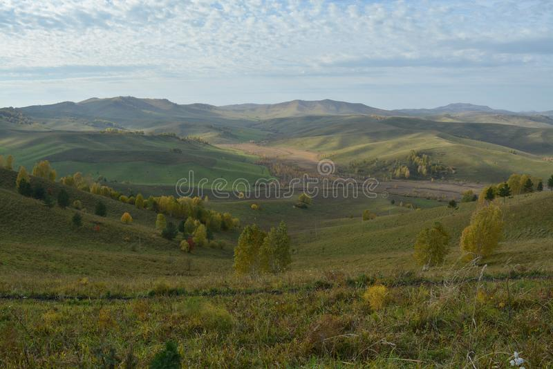 Green brown yellow valley hills autumn Russia. Forest yellow green valley bright autumn park Russia view of the valley hills horison royalty free stock images