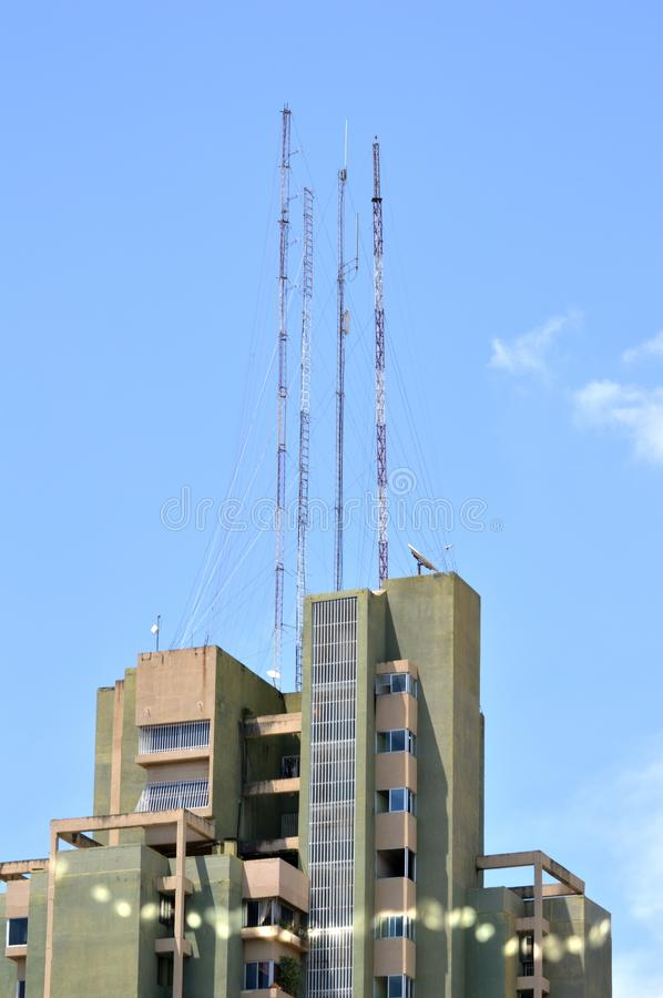 Green building and antennas royalty free stock image