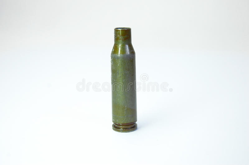 Green bullet from Kalashnikov automatic rifle at white background stock image