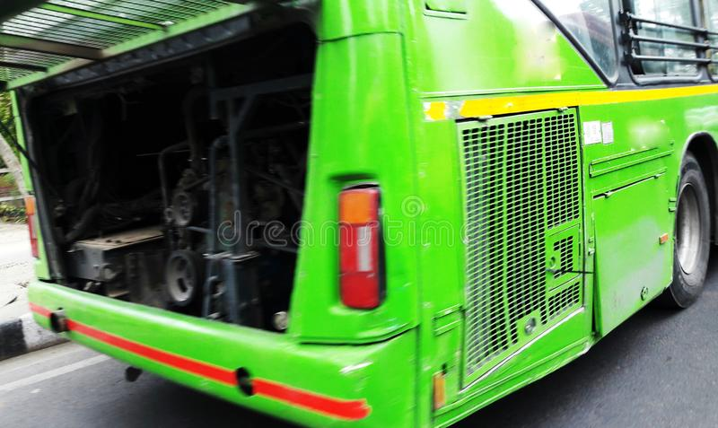 Green bus at road side with fault in engine. Wheel, auto, adult, public, interior, steering, transport, car, tour, rapid, cab, tourism, male, profession stock photos