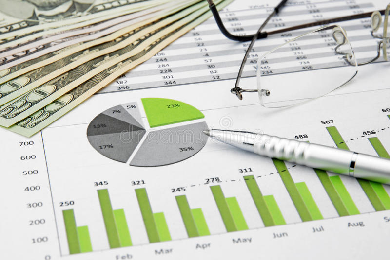 Green business chart and dollar. Green Business Charts with Dollar Money, Glasses and pen royalty free stock photos