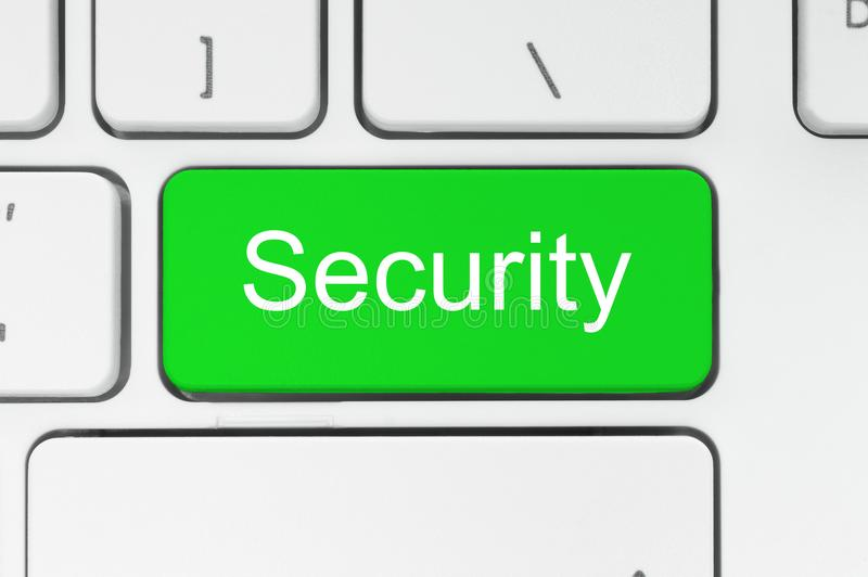 Green button with security word on the keyboard stock photo