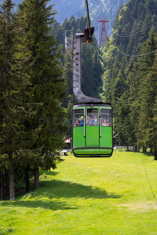 Green cable car cabin royalty free stock photography