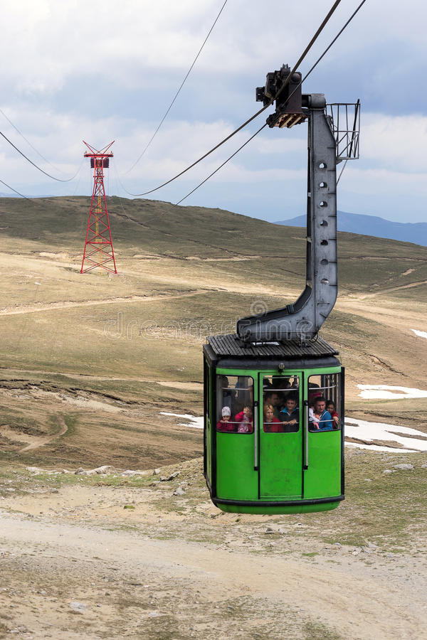 Green cable car royalty free stock photography