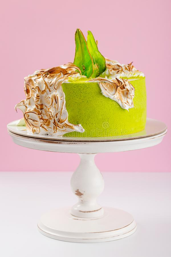 Green Cake Decorated With Burned Meringue And Colored Pear Stock