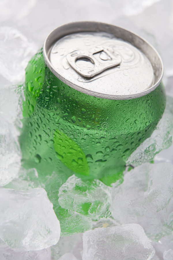Green Can Of Fizzy Soft Drink Set In Ice.  stock image