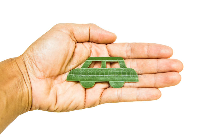 Green car in hand royalty free stock photography