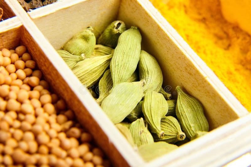 Green cardamom or cardamon seeds. Various dry spices royalty free stock photos