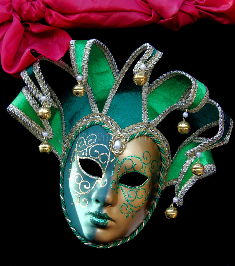 Green Carnival Jester mask with bells royalty free stock photo