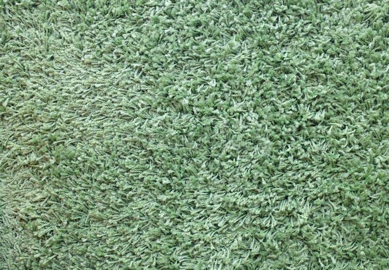 Green Carpet or doormat texture background stock photos