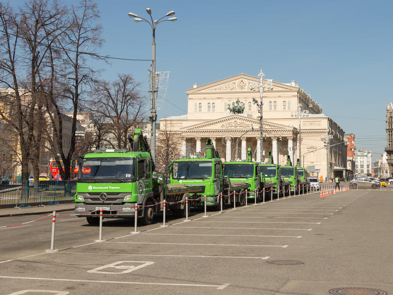 Green cars for evacuation. Moscow - April 12, 2015: A column of green truck for the evacuation of improperly parked cars on duty in front of the Bolshoi Theater royalty free stock photos