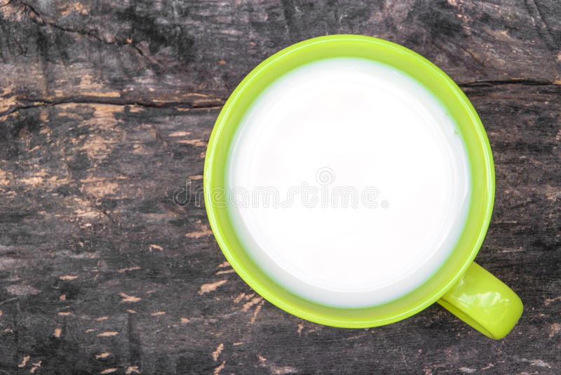 Green ceramic cup with organic milk royalty free stock photo