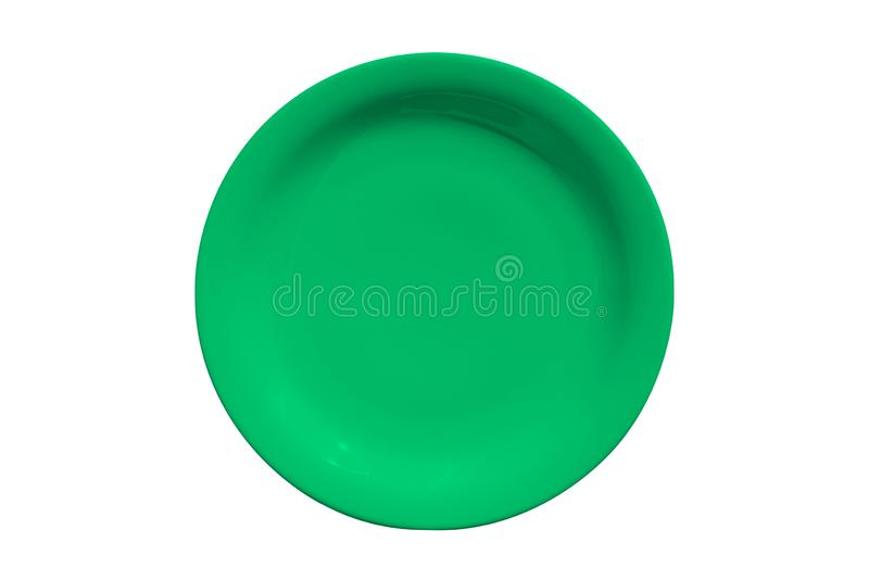 Green ceramic round plate isolated on white background royalty free stock photos