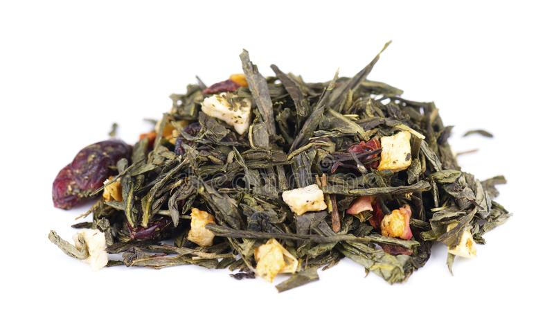 Green Ceylon tea with berries and fruits - apple, dog-rose, strawberry and cranberry, isolated on white background. stock photos