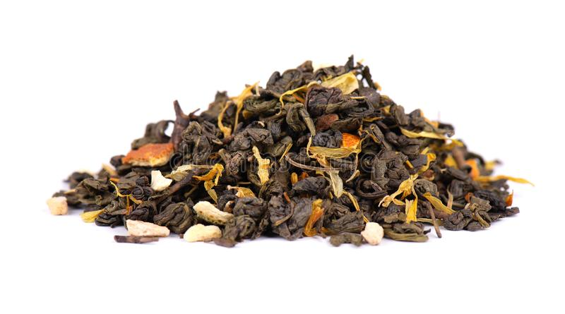 Green Ceylon tea with dry flowers and candied orange, isolated on white background. Close up. stock photography