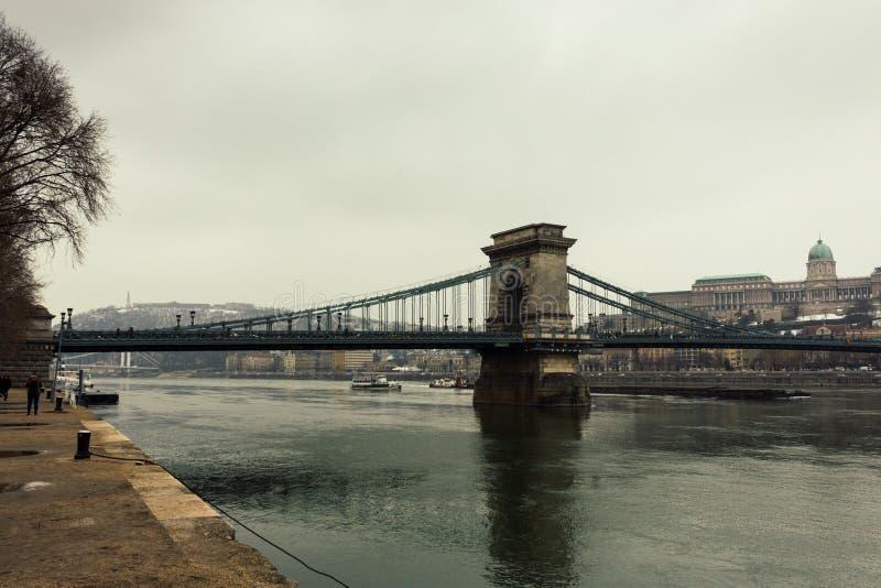 Green chain bridge in Budapest, Hungary. Budapest and Danube river landmark retro filtered. European capital cityscape. Winter Budapest landscape.Danube river stock image