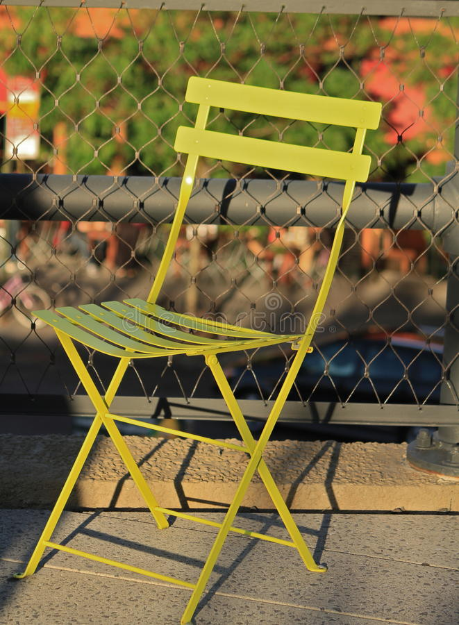 Green chair. Stylish green chair in outdoor garden royalty free stock images