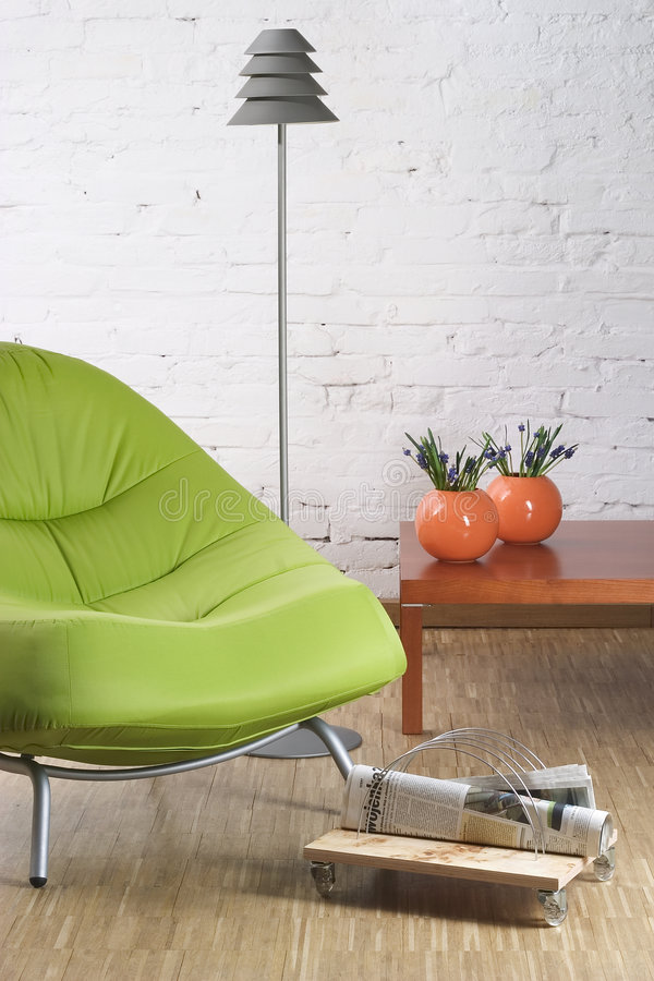 Green chair. On wooden floor royalty free stock images