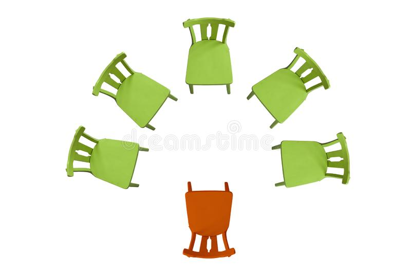 Green chairs stand on a white background in a semicircle, one orange chair, top view background, isolated. Concept of highlighting the main stock illustration