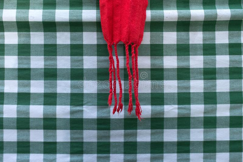 Green checkered tablecloth with red cloth. Typical of the tables in the Basque country royalty free stock photography