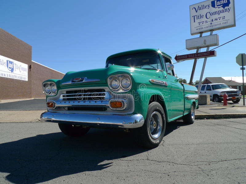 Green Chevy Apache truck or pickup at car show stock image