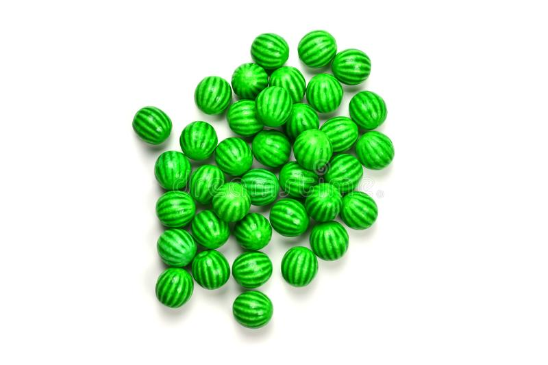 Green chewing gum isolated on white background. Top view. Space for text or design stock photography