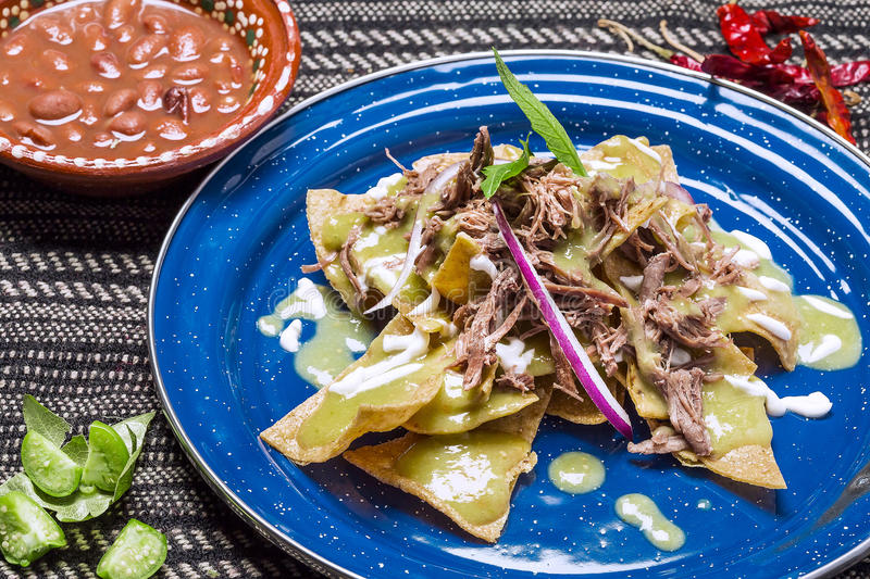 Green Chilaquiles with meat royalty free stock images