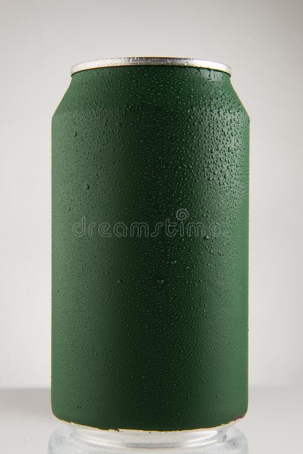 Green chilled can. Of soda with drops on white background and drop, in front view royalty free stock photos