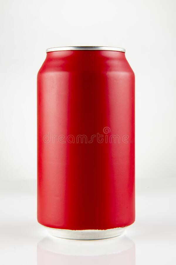 Red chilled can. Green chilled can of soda with drops on white background and drop, in front view stock photos