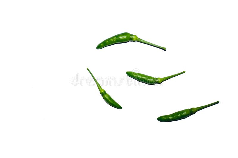 Green chillies Against a white background. Intersecting with a white background stock photography