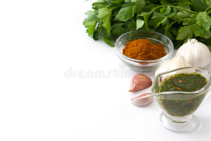 Green Chimichurri Sauce and ingredients. Isolated on white background stock photography