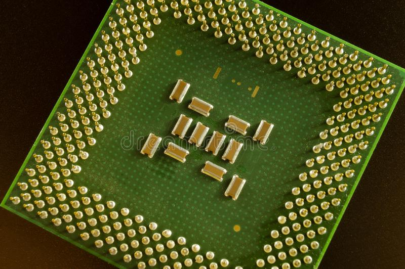 Green chip CPU closeup of the old computer stock photos