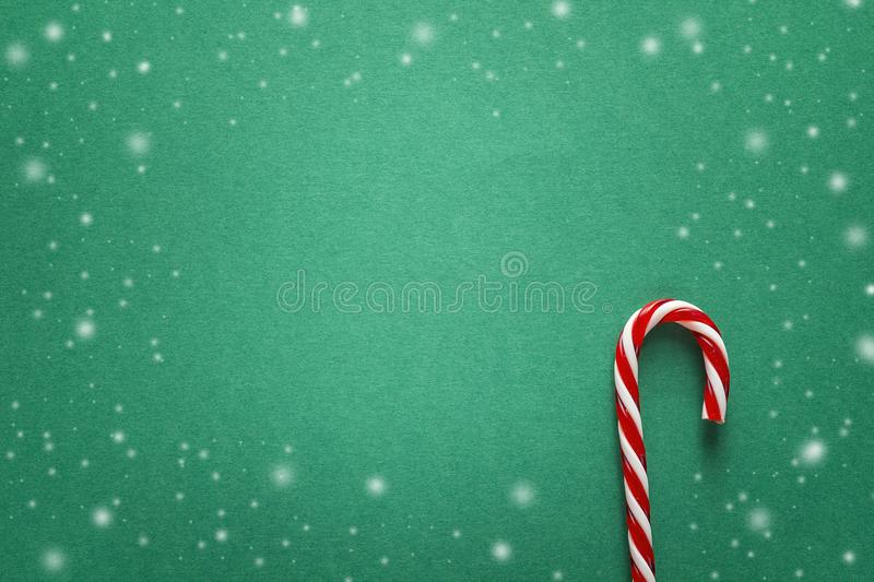 Green Christmas background with red candy canes. Copy space for text. royalty free stock photo