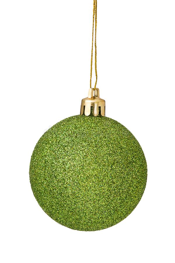 Green Christmas Ball hanging from golden string Isolated on white royalty free stock photography