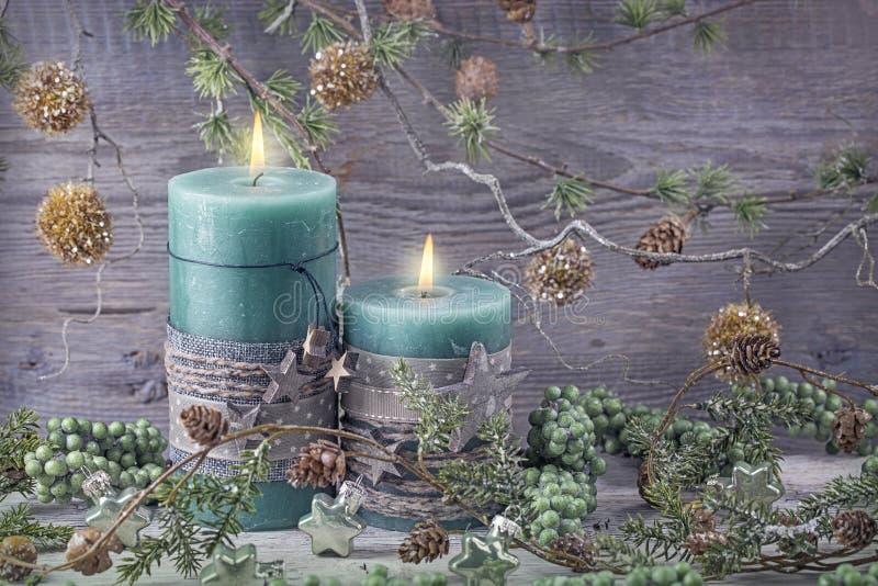 Green christmas candles stock photo