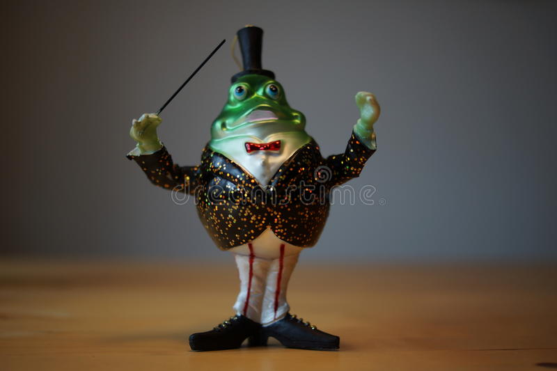 Green Christmas decoration Frog. In a suit royalty free stock photo