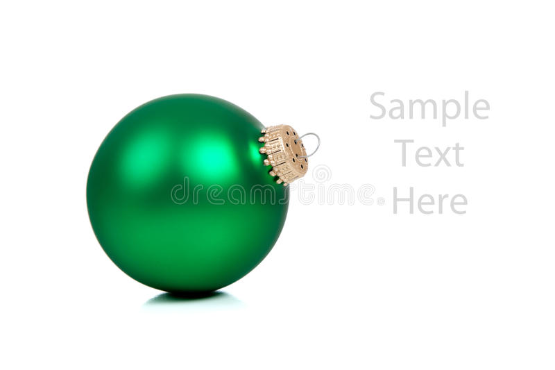 A green Christmas ornament/bauble on white stock photo
