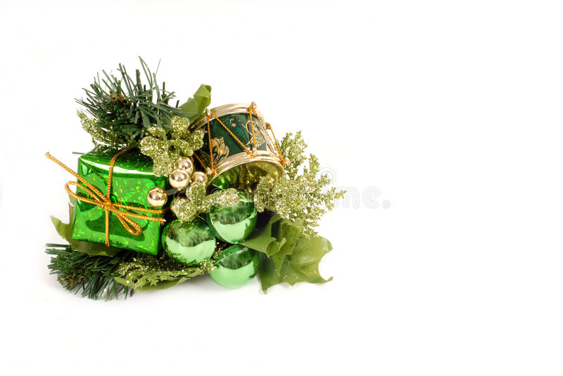 Green Christmas ornament isolated on white. Green Christmas ornament with small wrapped package, green orbs and a small drum isolated on white stock image