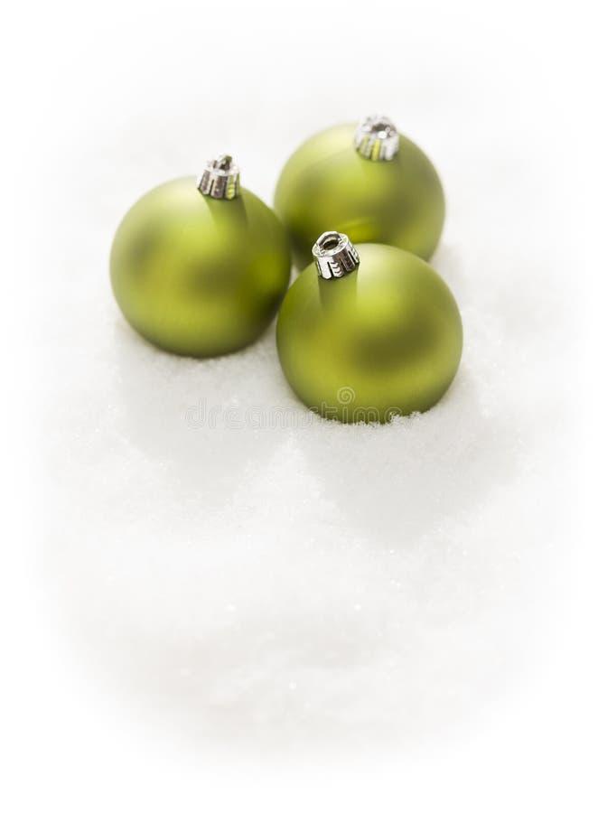 Green Christmas Ornaments on Snow Flakes  on White