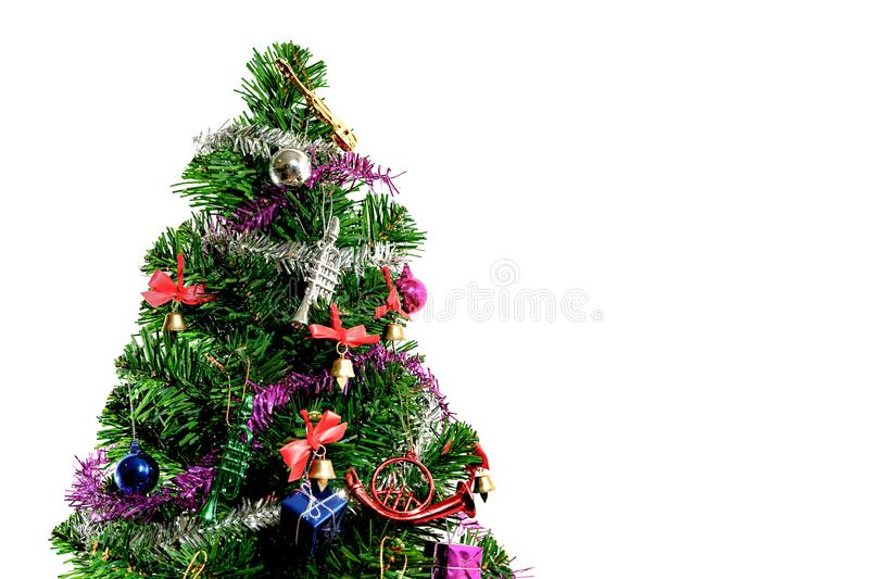 Green Christmas tree decorated with gifts And white background. Holiday, star, toys, new, wrap, decoration, festive, ornament, eve, year, bauble, santa, ribbon royalty free stock photo