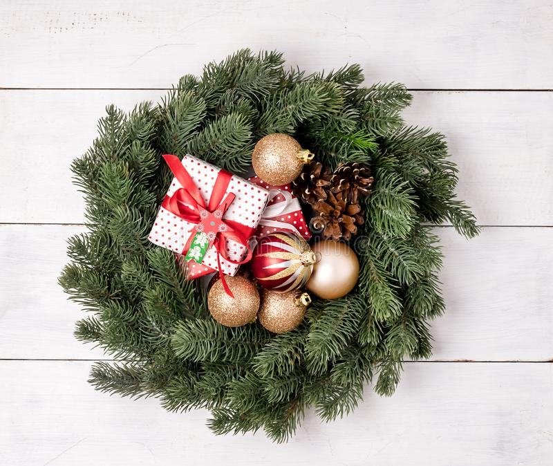 Green Christmas Wreath with Decorations on White Wooden Background Christmas Card Christmas Gift Box Top View Flat Lay royalty free stock photos