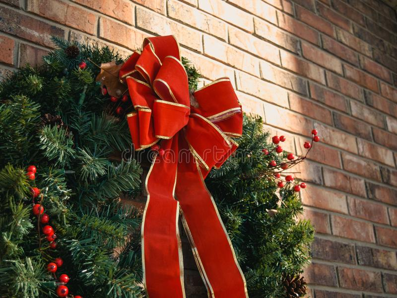 Green Christmas Wreath With Red Bow stock image