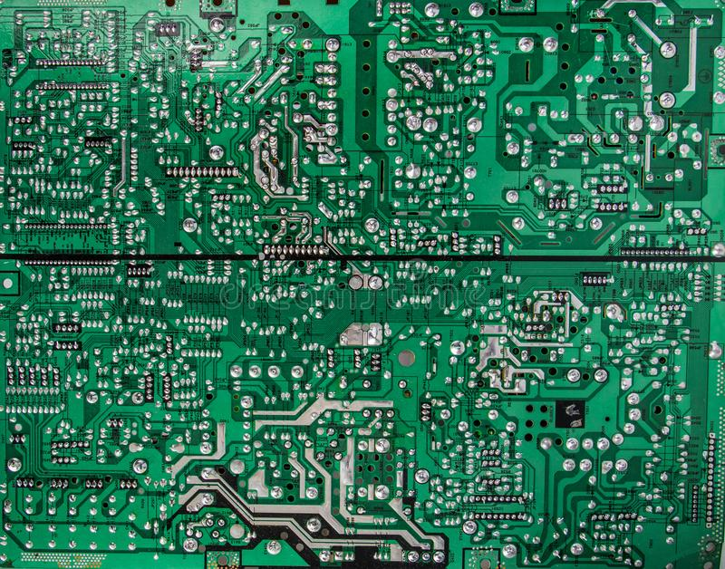Flat image of green circuit board with many electrical components royalty free stock images