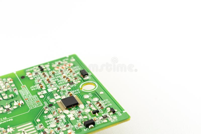 Green circuit board with installed microprocessor on white background. Computer hardware and electronic component stock photos